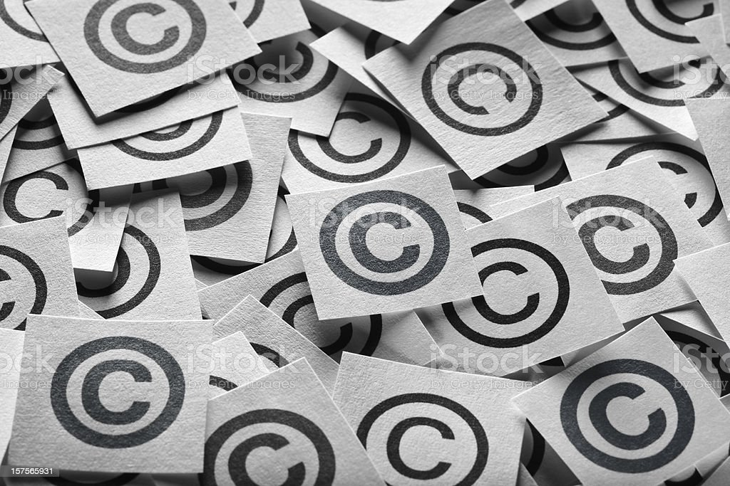 Various copyright sign on a square paper stock photo
