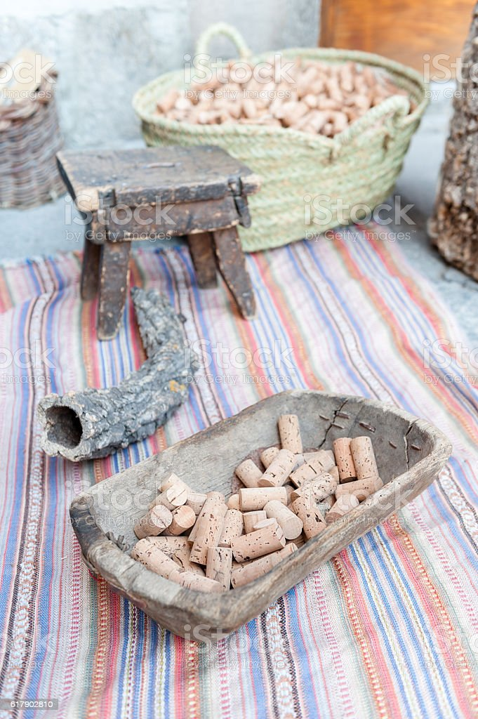 various corks in the foreground with bark of cork oak stock photo