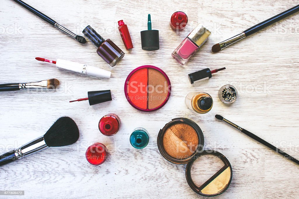 Various cosmetics are on a white table stock photo