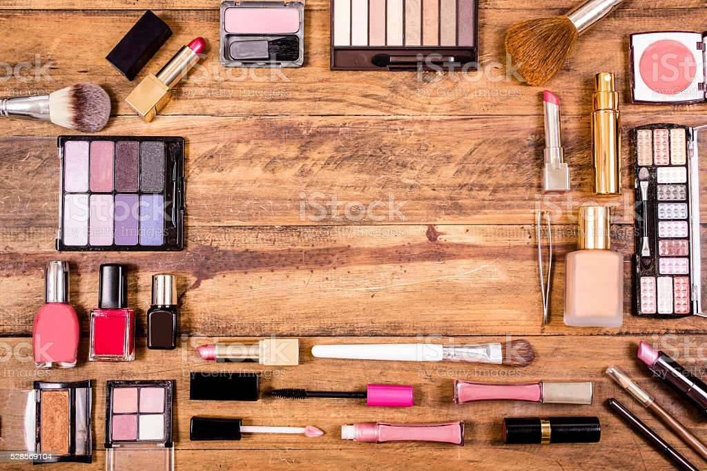 Various cosmetics, make-up lie on wooden dressing table. Knolling. stock photo