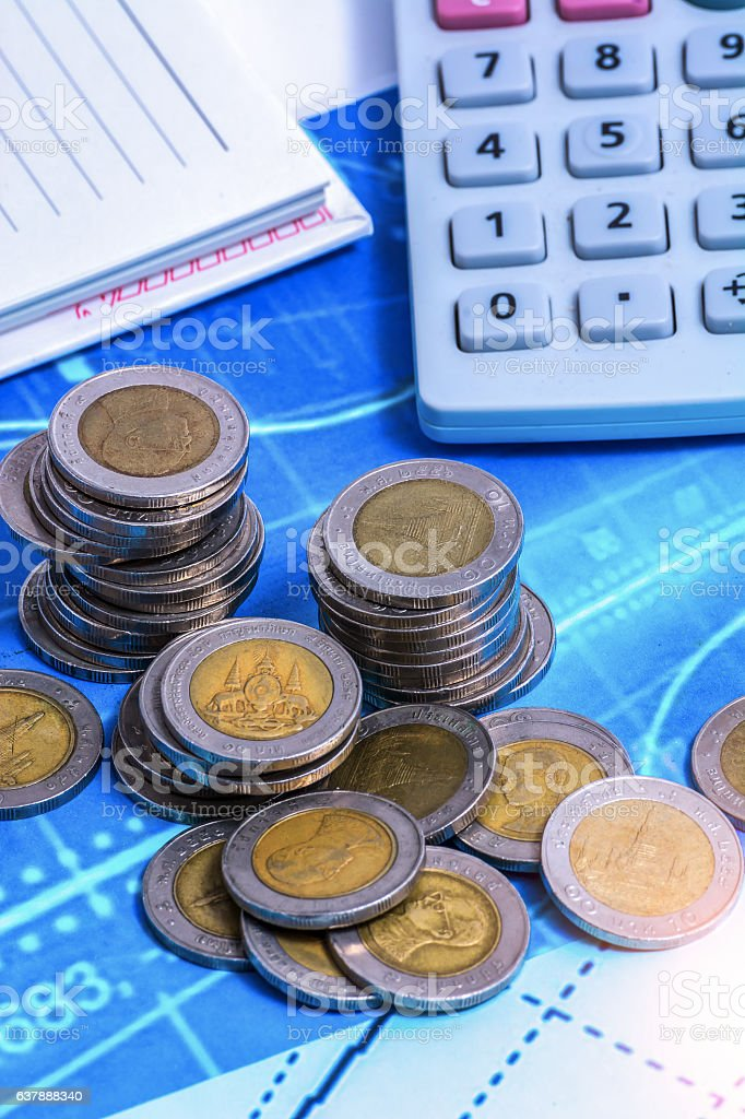 Various currency notes and coins stock photo