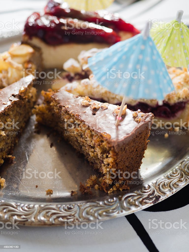 Various delicious slices of cakes stock photo