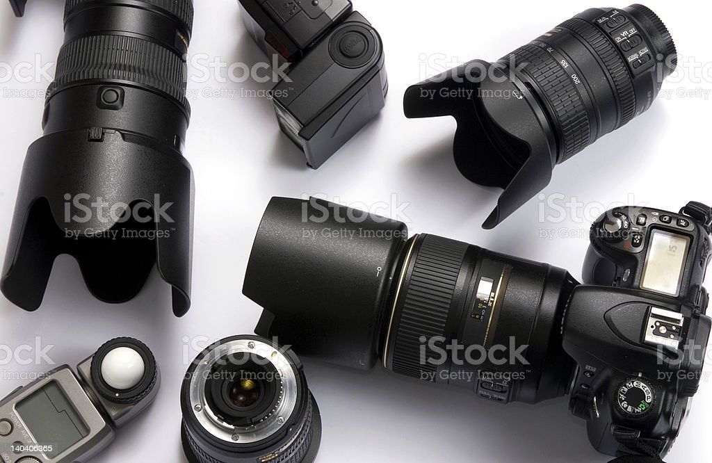 Various digital camera equipment on a white background stock photo