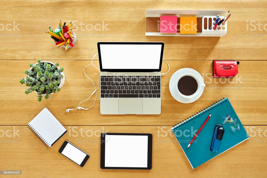 Various technologies with office supplies, coffee cup and housep stock photo