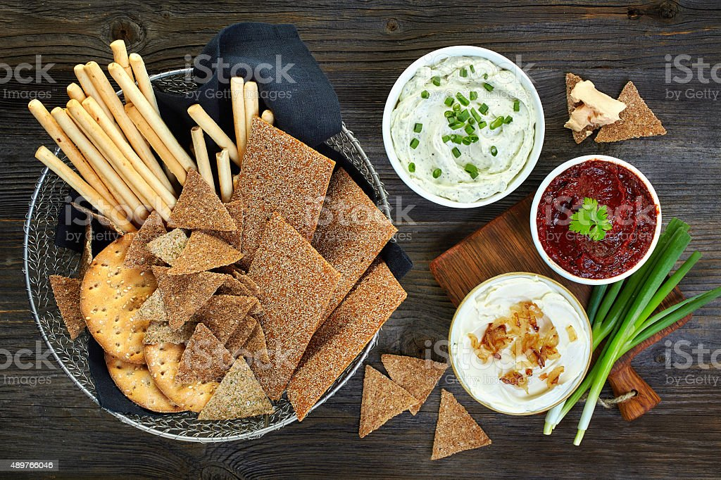 various dip sauces and bowl of bread cookies stock photo