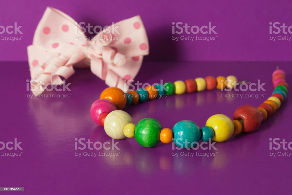 Various elastic bands, hair clips, beads, bows for girls. stock photo