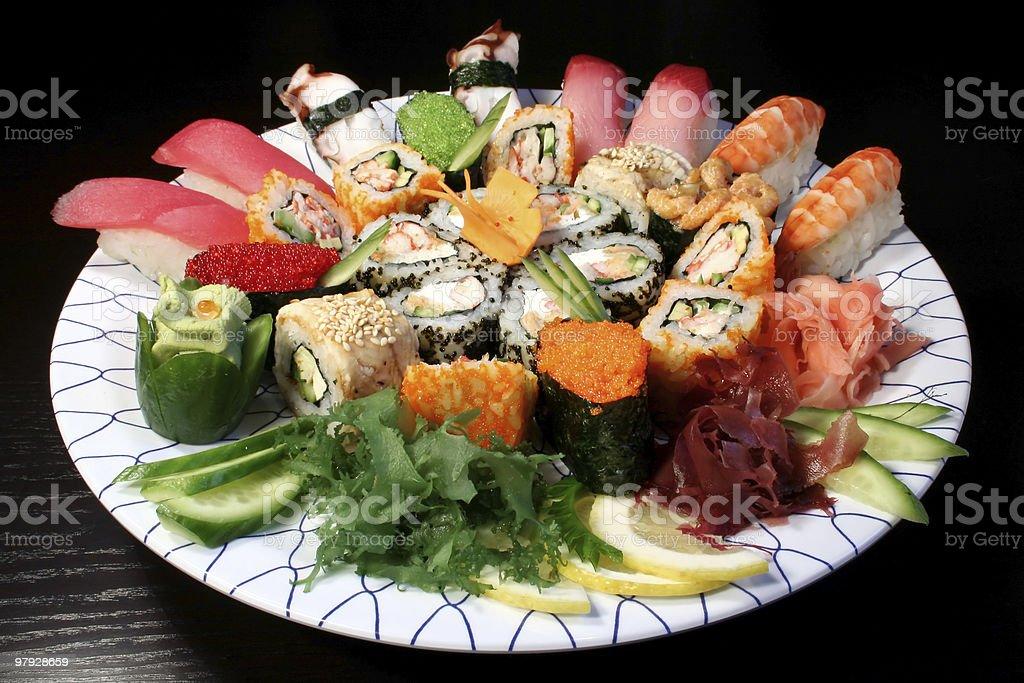 Various examples of sushi, sushi rolls, and sashimi royalty-free stock photo