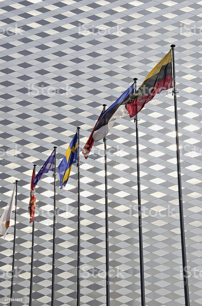 various flags on modern architecture background royalty-free stock photo