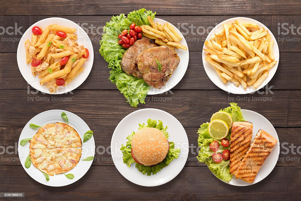 Various food set on the wooden background stock photo