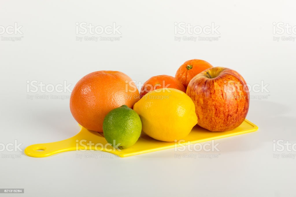 Various Fruit Medley on Cutting Board stock photo