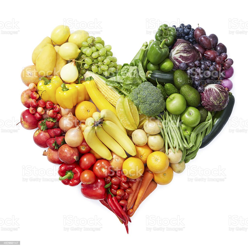 Various fruits and vegetables forming heart shape stock photo