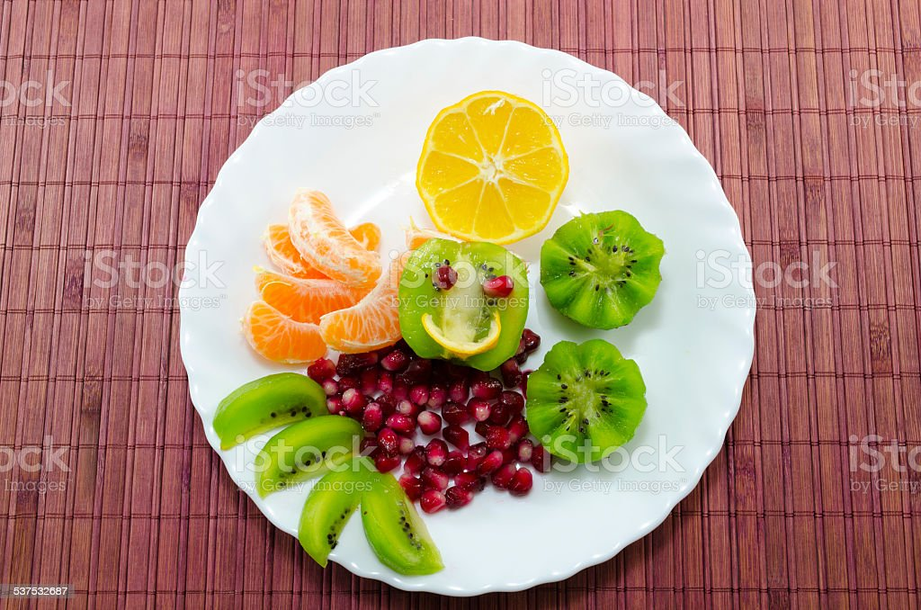 Various fruits on a white plate royalty-free stock photo