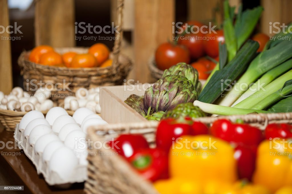 Various fruits, vegetables and eggs in organic section stock photo