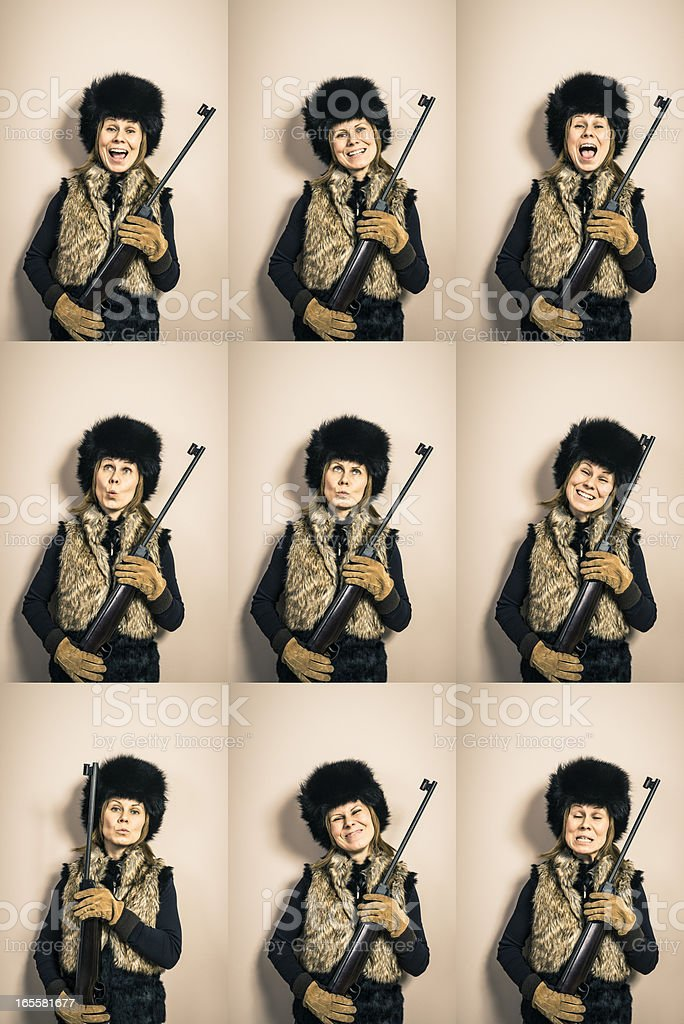 Various funny woman's hunter portraits with shotgun, against wall, studio royalty-free stock photo
