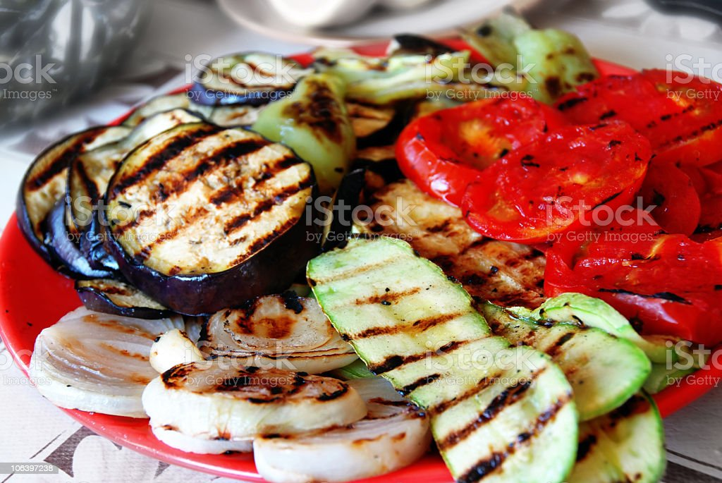 Various grilled vegetables on a red plate royalty-free stock photo