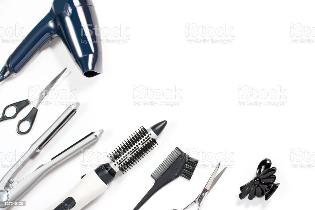 Various hair styling tools on white background stock photo