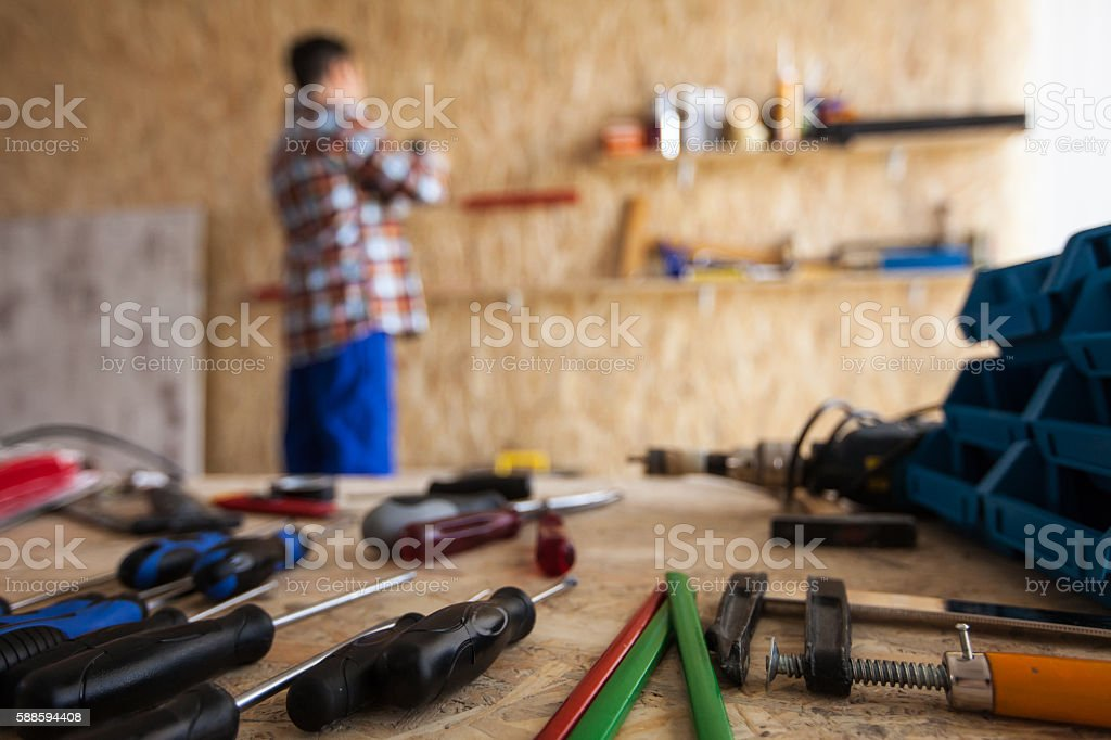 Various hand tools in workshop stock photo