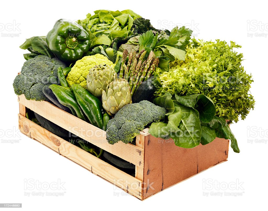 Various healthy green vegetables on a wooden box stock photo
