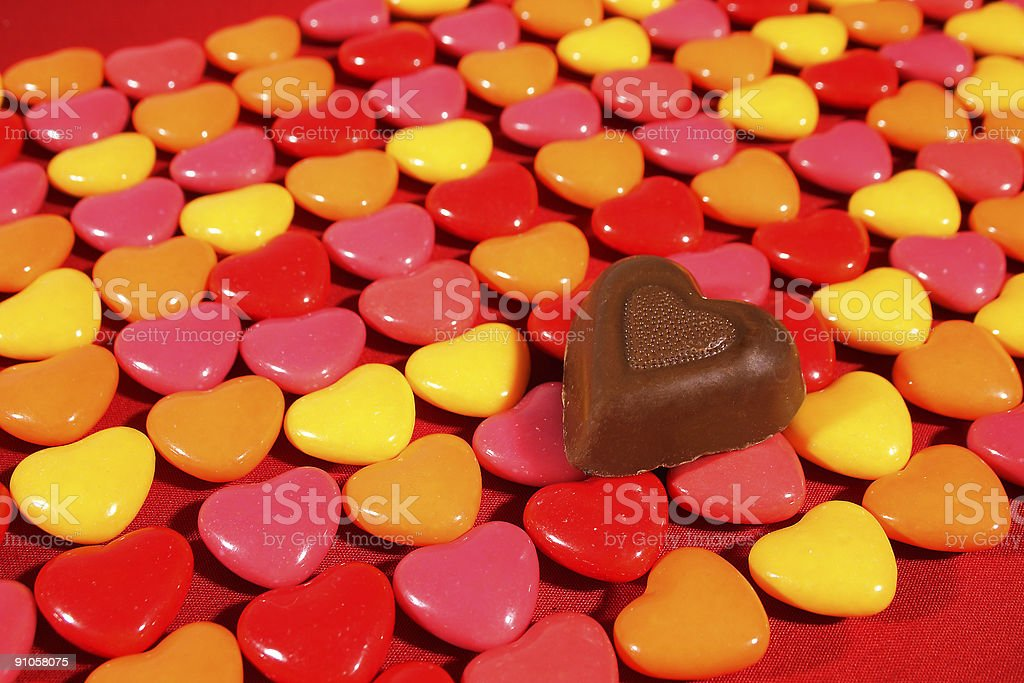 Various heart candies with one chocolate royalty-free stock photo