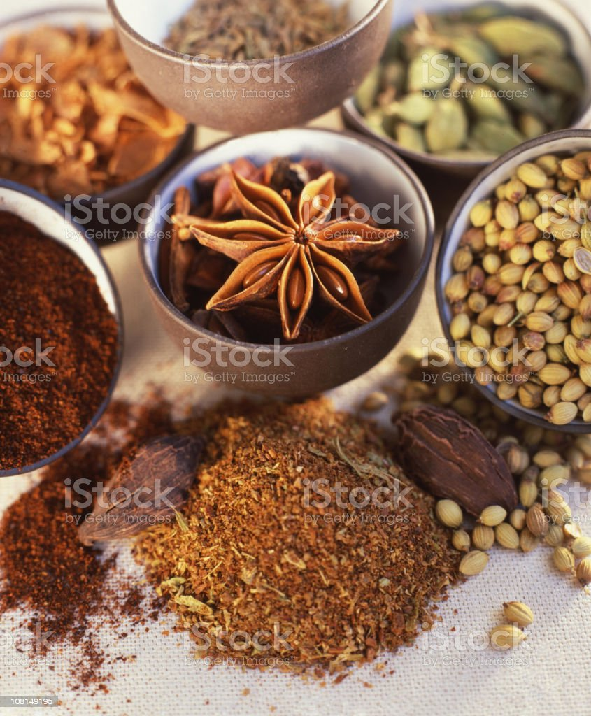 Various Herbs and Spices on Display in Bowls royalty-free stock photo