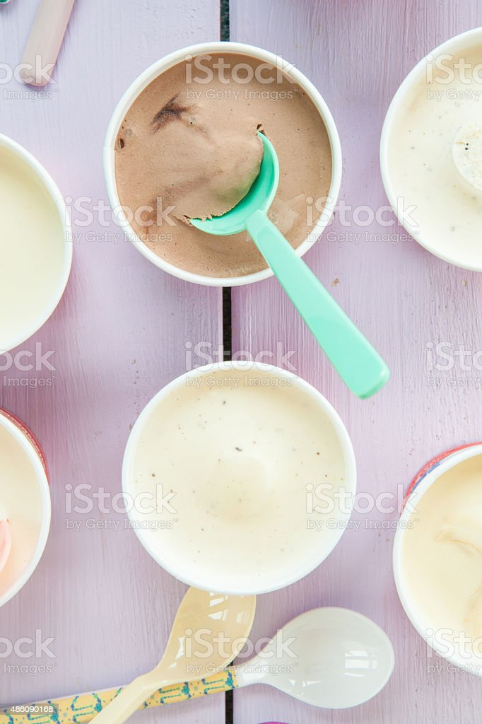 Various ice creams in small paper cups stock photo