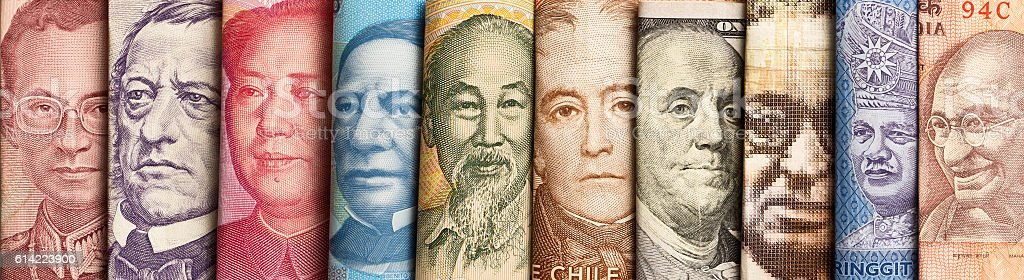 Various International Currency with World Leaders Portraits stock photo