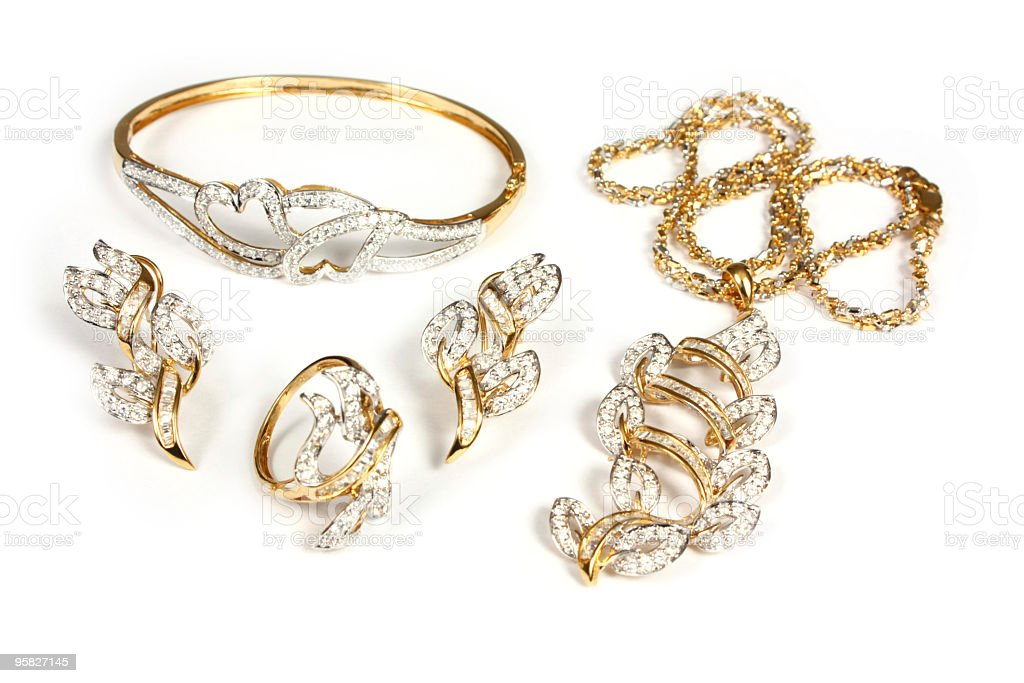 Various items of gold and diamond jewelry stock photo