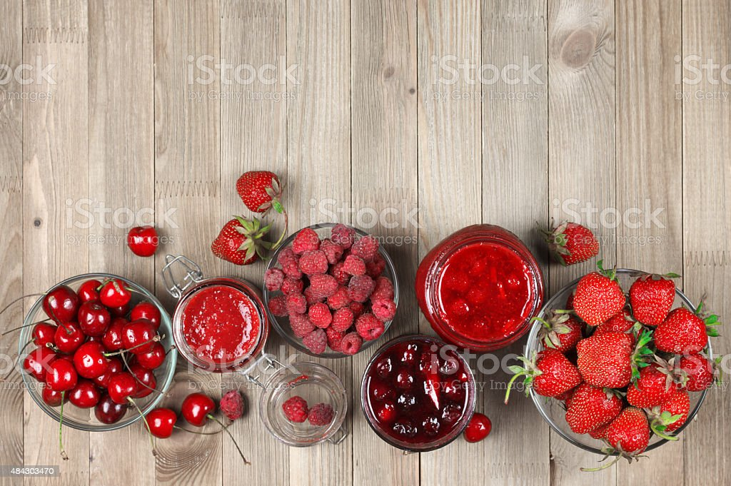 Various jams and berries stock photo