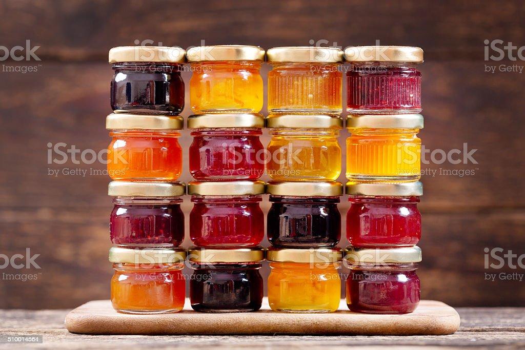 various jars of fruit jam stock photo
