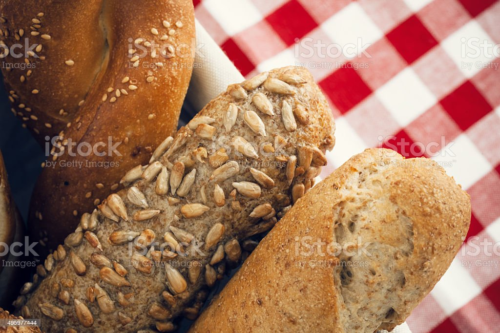 Various kinds of fresh bread. Shallow DOF stock photo