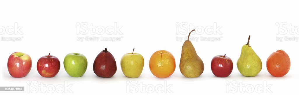 Various kinds of fruits lined up on white background stock photo