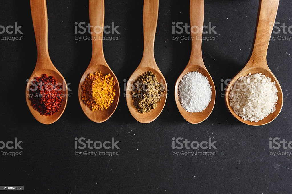 Various kinds of spices and rice stock photo