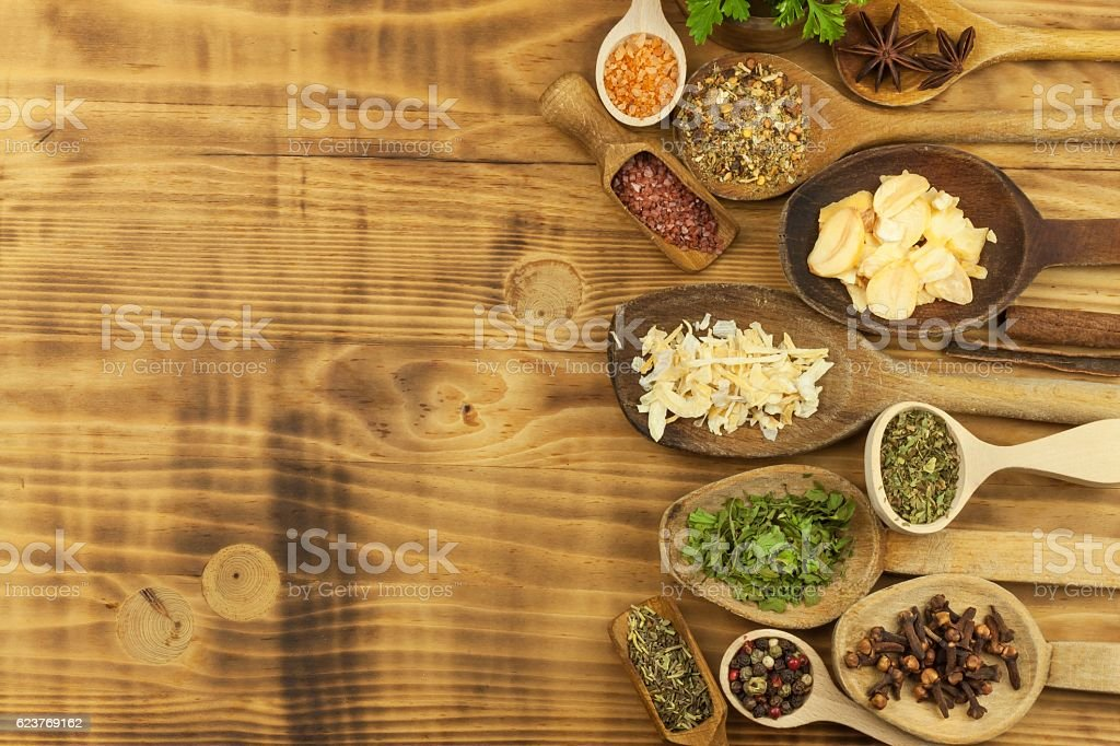Various kinds of spices on the kitchen table. Seasoning food stock photo