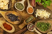 Various kinds of spices on the kitchen table. Seasoning food
