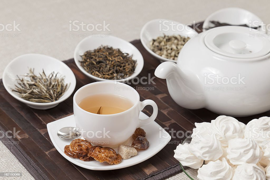 Various kinds of tea with cup and teapot royalty-free stock photo