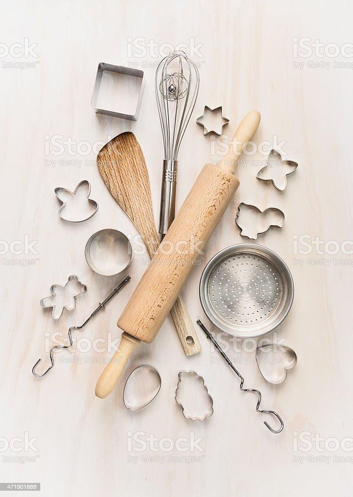 various kitchen bake utensils on white wooden table, top view stock photo