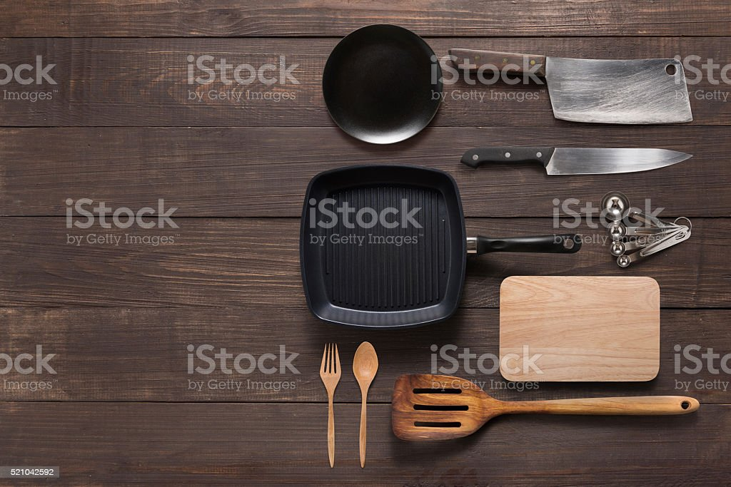Various kitchenware utensils on the wooden background for cookin stock photo
