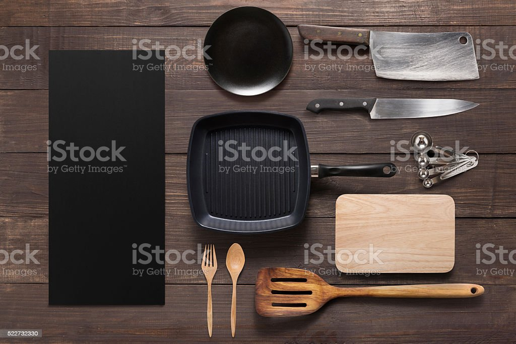 Various kitchenware utensils on the wooden background stock photo