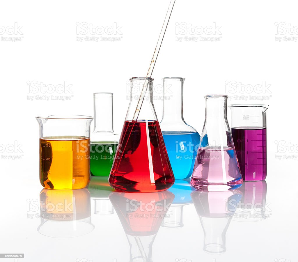 Various laboratory flasks with a colored liqiuds stock photo