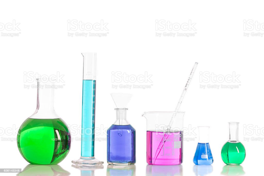 Various laboratory flasks with a colored reagents, pipette stock photo