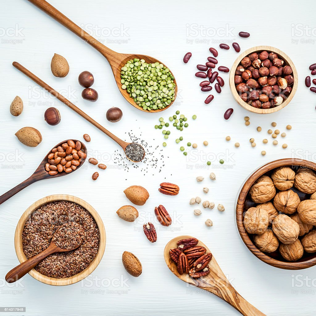 Various legumes and different kinds of nuts. stock photo