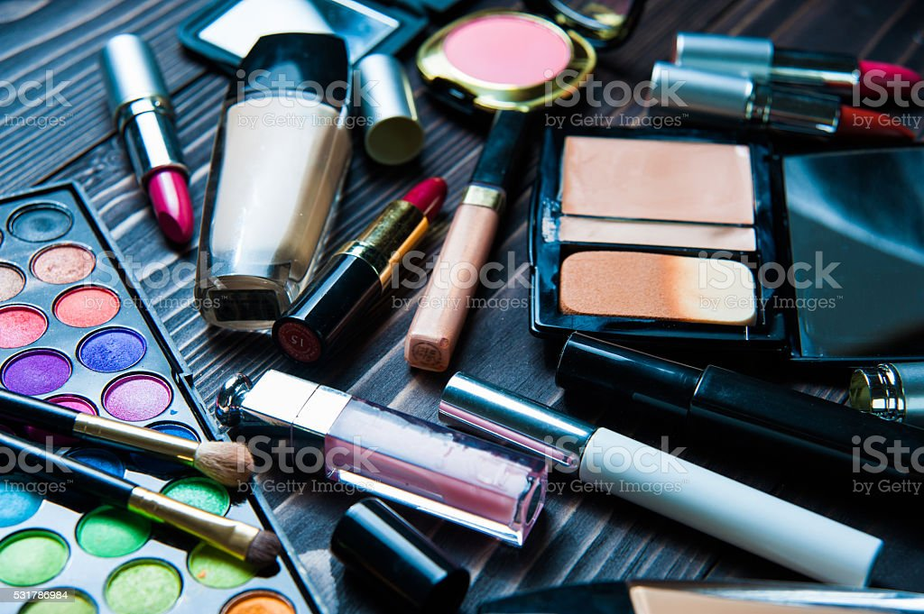 Various makeup products on dark background. Cosmetics make up artist stock photo