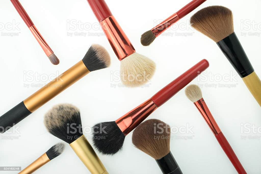 Various makeup products on white background with copyspace stock photo