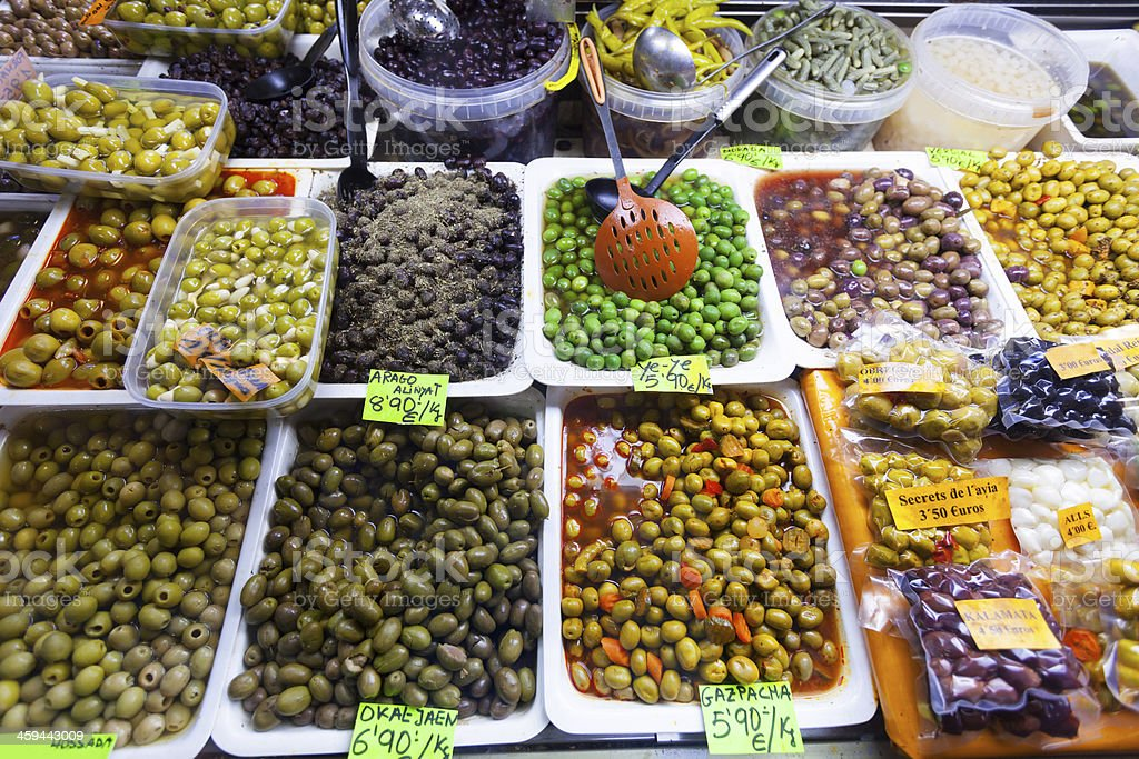 Various marinated olives in cans stock photo