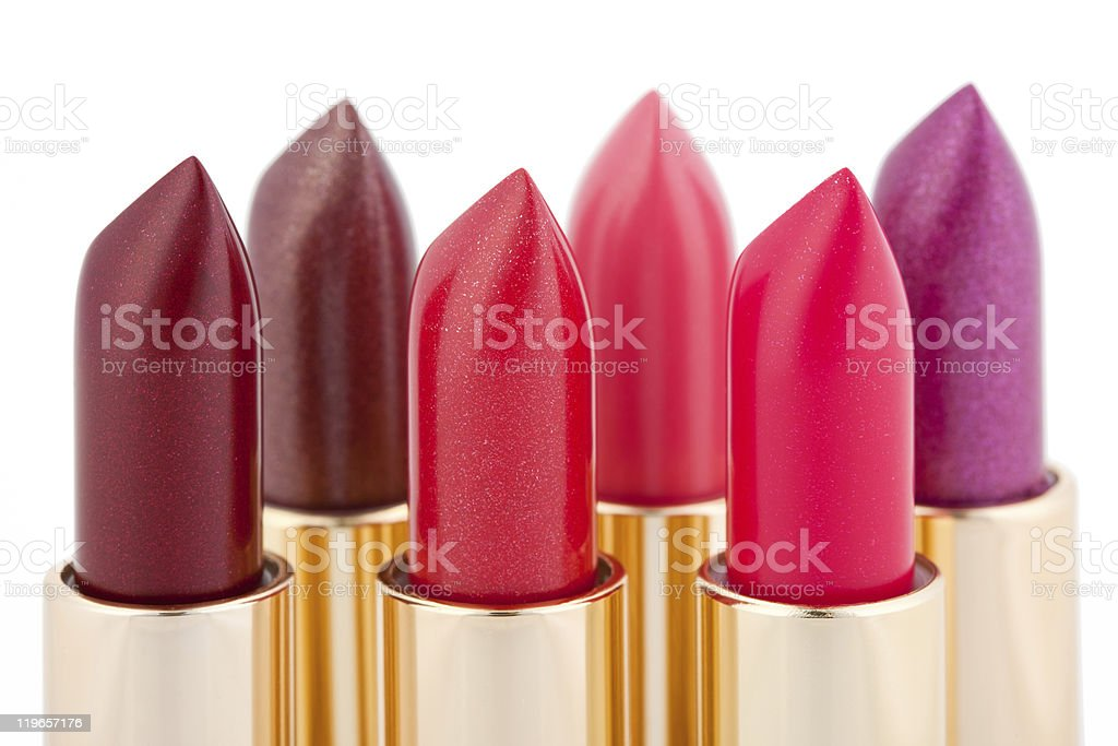 Various multicolored lipsticks arranged in two lines stock photo