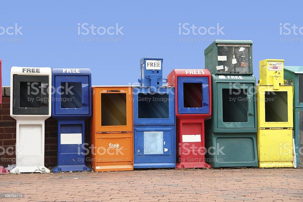 various news racks in a row stock photo