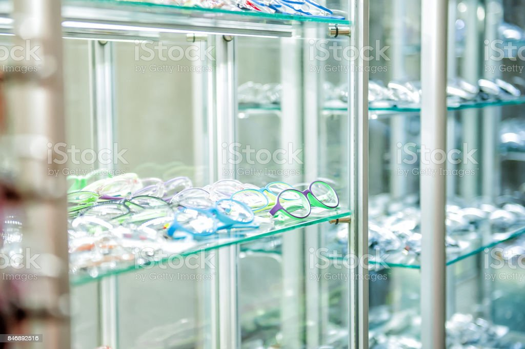 Various of eye glasses on the shelf in the optic shop. Selective focus. Space for text stock photo