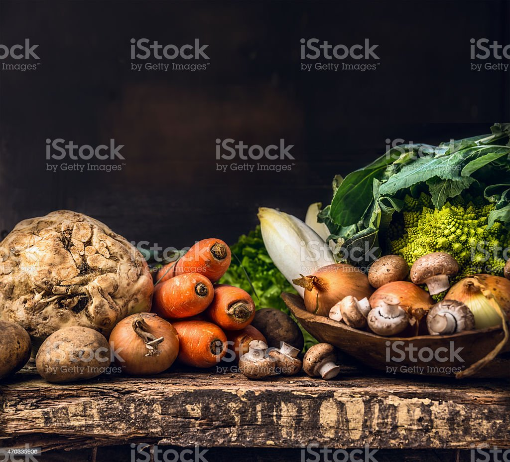 various of raw vegetables and field mushroom on wooden table stock photo