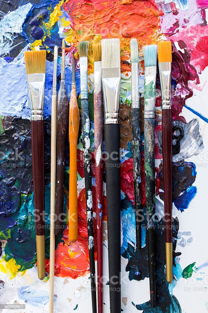 Various Paintbrushs on a Palette stock photo