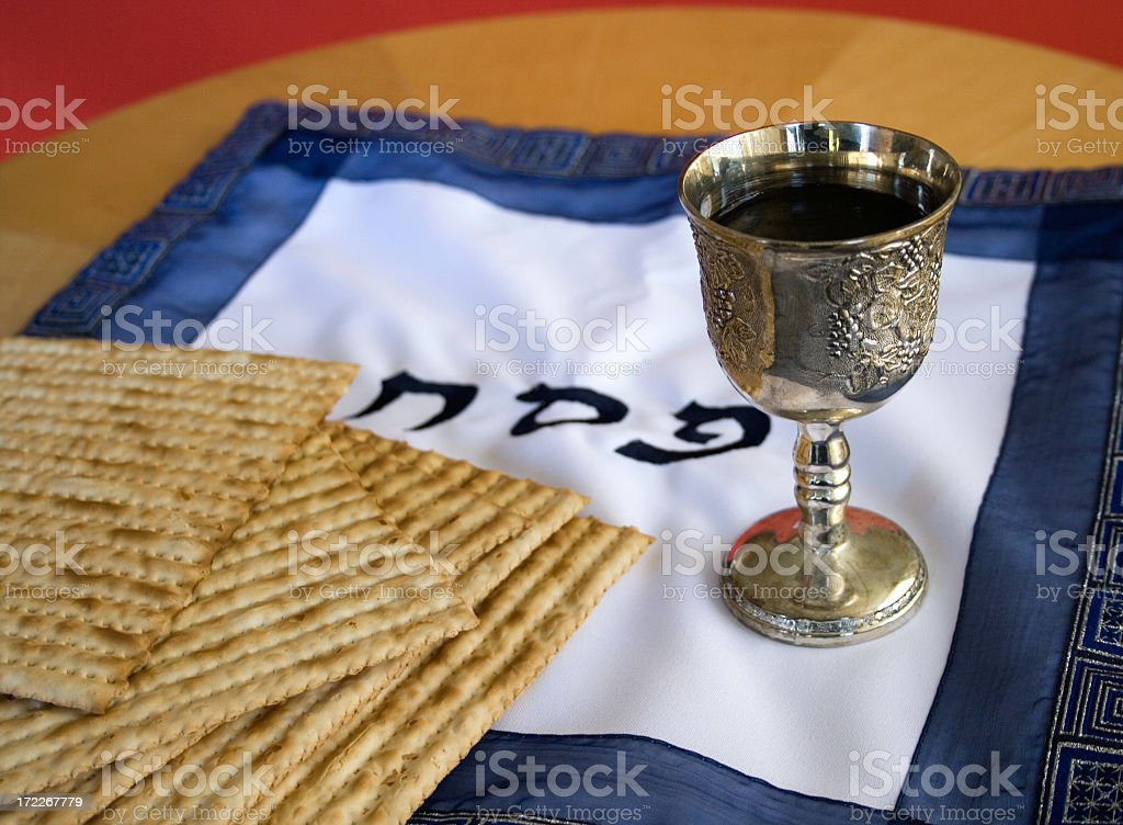 Various Passover items on wooden table stock photo